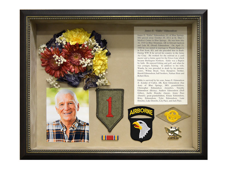 Display preserved funeral memorial flowers in an elegant shadow box with sentimental items from your loved one.