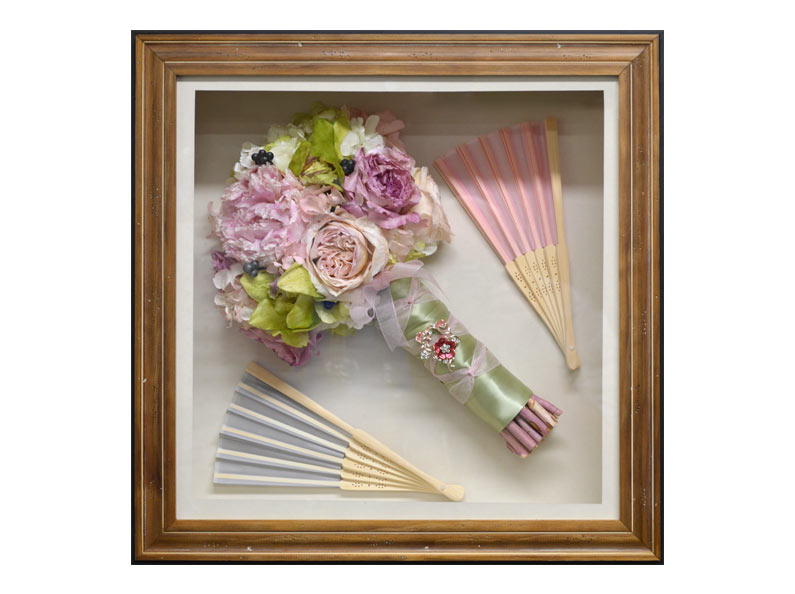 Another beautiful preserved wedding bouquet encased in a shadow box with accessories.