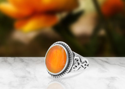 Orange preserved flowers handcrafted into a gorgeous ring.