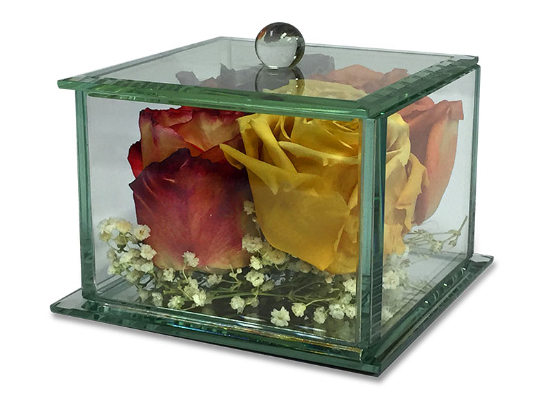 Affordable flower preservation options can include glass boxes, domes and other small clear encasements.