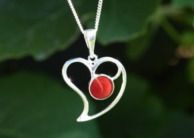 Sterling silver heart necklace created from red preserved flower petals.
