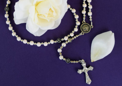 Precious white petal rosary created from preserved funeral flowers.