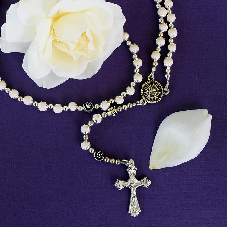 Rosaries created from preserved flowers (white roses)
